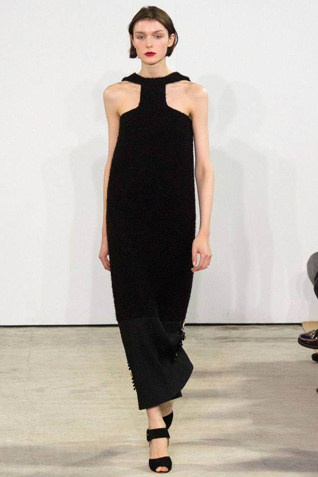 <strong>Emilia Wickstead</strong> <br><br> A black column gown with a t-shape neckline fell more into the '60s three-martini lunch era—finished with a slightly smudged rep lip, like she'd been kissed before heading out for the evening.