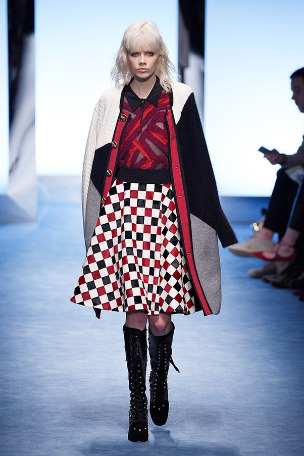 <strong>FAUSTO PUGLISI</strong><br><br> The good news is that Puglisi doesn't serve his American cheese literally. It's done with a Milanese sense of fun and mischievousness and some sex. Cardigans, poodle skirts and sweatshirts were either tweaked into oversized proportions or spun into graphic red, white, blue and black patterns and his signature starburst and then paired back to slick black leather.