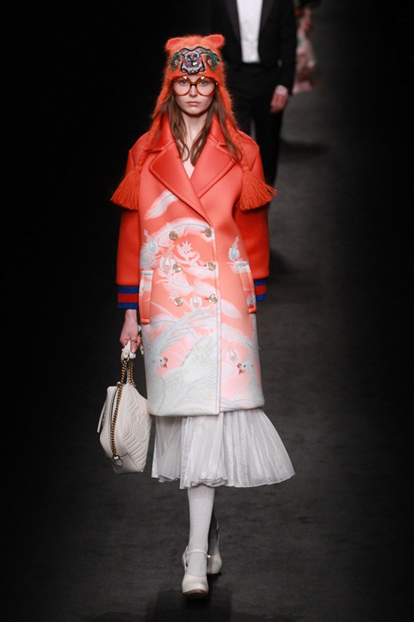 <strong>GUCCI</strong><br><br> Charm, wit, irreverence and fun is what the new Gucci is all about, and so are great clothes that women from different tribes and demos will want to wear. A yellow Big Bird-esque coat may play to the editorialists, but a poppy red peacoat that devolves into a white pattern is visually interesting.
