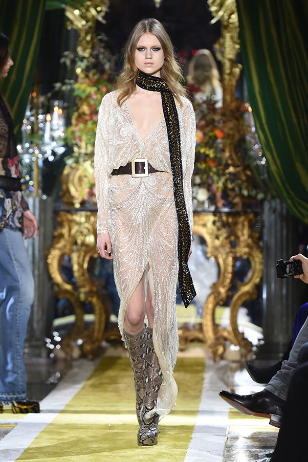 <strong>ROBERTO CAVALLI</strong><br><br> It was fun, fast and well-done, but it did feel a little <em>too</em> dead-on Seventies, which made moments where he eased up all the better. Like pairing killer python boots with a beaded wrap dress cinched with a pirate belt.