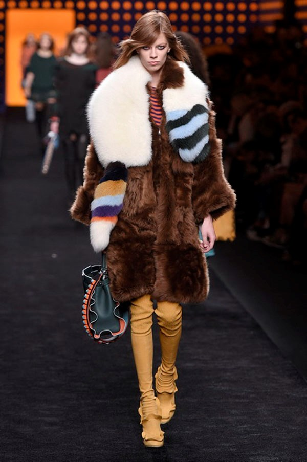 <strong>FENDI</strong><BR><BR> But for these 12 minutes, the focus was on what Lagerfeld and Silvia Venturini sent out on the model creatures. The fall collection riffed on a mild Seventies theme that centred around a wavy striped motif which danced across printed furs, colourful knit tees, silky dresses and all the loose ruffles that accented everything from necklines, cuffs, peplums and hems to the colourful bags and thigh-high sock boots.