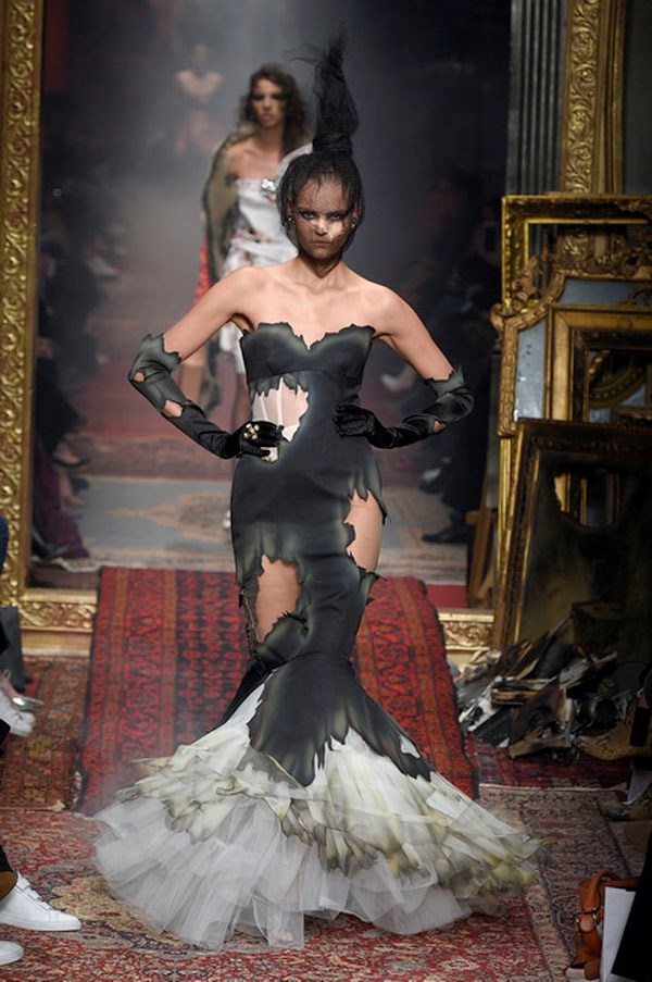 <strong>MOSCHINO</strong><BR><BR> From there, Scott's runway imagination was on fire. Like, really on fire. A series of party dresses and tuxedos (which were smartly done) were burnt at the edges and some still smoking. The effect delighted the crowd and any closeted pyros.