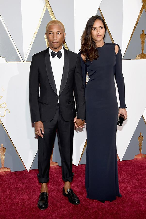"""<strong>Pharell Williams:</strong> <br><br> """"If one man can pull of an exposed ankle at the Oscars, it is going to be Pharrell. Love it"""" - Hannah McLennan, editorial coordinator/bookings editor. <br><br> """"Pharrell is kind of my style hero. And the no socks, rolled up pant look is working. Not too sure about the hair though."""" - Pete Harrison, group commercial category manager."""
