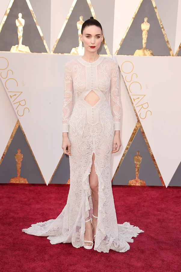 """<strong>Rooney Mara:</strong> <br><br> """"It's perfect but why do I feel like I've seen this on her a zillion times before?"""" - Jessica Matthews, deputy chief sub editor <br><br> """"Always on point. I really admire how she always looks effortlessly cool but also dressed to the occasion. I love the hair and makeup paired with this ethereal Givenchy dress. The cut-out makes the dress very modern."""" - Caroline Tran, market editor <br><br> """"The whole exposed-stomach-keyhole thing would usually not be my thing, but this Givenchy dress is perfect for Rooney, she always nails it."""" - Hannah McLennan, editorial coordinator/bookings editor"""