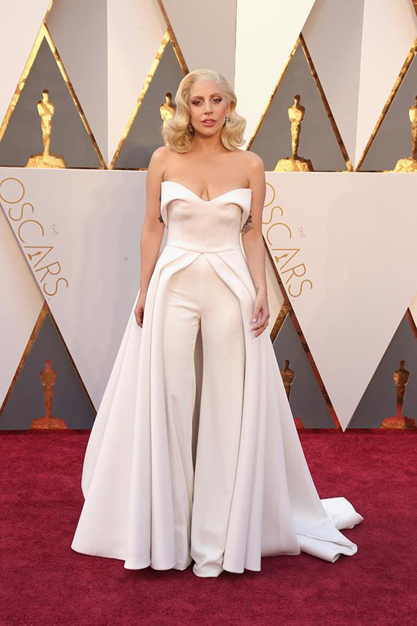"""<strong>Lady Gaga:</strong> <br><br> """"I see where designer Brandon Maxwell was going with this jumpsuit-cum-gown but it just doesn't quite work for me. It's ill-fitting and I'd much rather have seen her play with gender roles on the red carpet in a power suit, a la the <a href=""""http://www.harpersbazaar.com.au/people-parties/flash/2016/2/best-red-carpet-moments-grammy-awards-2016/best-red-carpet-moments-grammy-awards-2016-image-30/"""">custom Marc Jacobs</a> she wore to pay tribute to David Bowie at the Grammys."""" - Grace O'Neill, digital content manager <br><br> """"I get the idea but it is ill fitting and not flattering on her."""" - Pete Harrison, group commercial category manager.<br><br> """"Pelmet on pelmet on pelmet. There's more fabric going on than at an Adairs clearance sale."""" - Tom Lazarus, chief sub editor"""