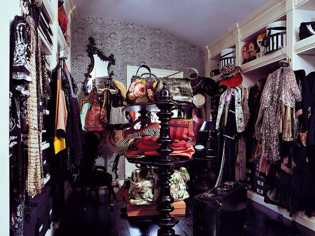 """<strong>Anna Sui</strong> <br><br> This organised chaos could only be Anna Sui's closet. In her New York home, a ramshackle collection of edgy vintage clothes presented against chinoiserie wallpaper highlights the magic behind the madness of her designs. <br><br> <a href=""""http://www.elledecor.com/celebrity-style/celebrity-homes/g1835/at-home-with-anna-sui/""""><em>ELLE Decor</em></a>"""