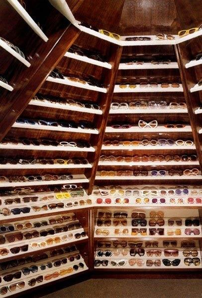 """<strong>Elton John</strong> <br><br> Racks and racks of sunglasses? Check. No outfit will go without an unmatched pair. <br><br> <a href=""""http://www.architecturaldigest.com/story/elton-john-david-furnish-los-angeles-home-article""""><em>Architectual Digest</em></a>"""