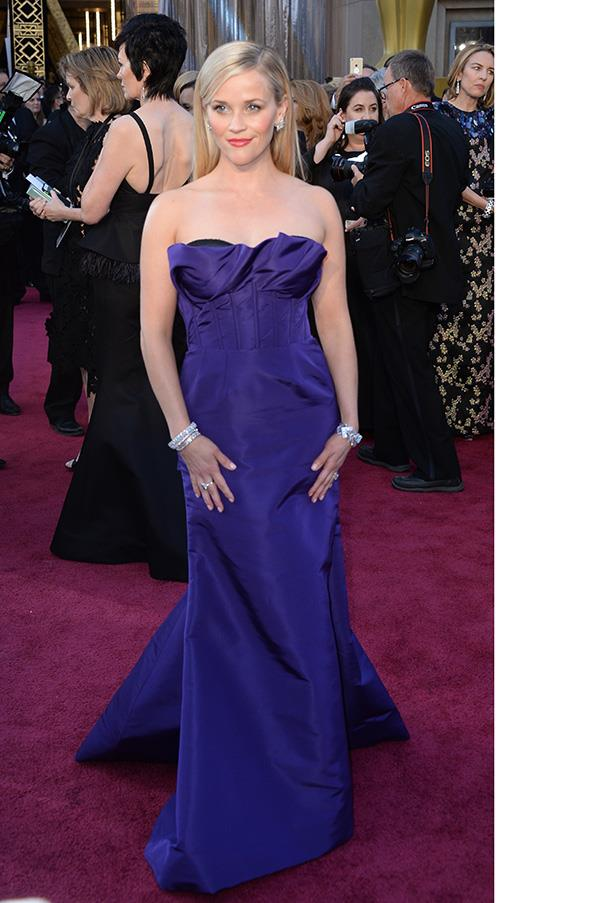 """<strong>Reese Witherspoon:</strong> <br><br> """"The Oscars has become too much of prom night and I think Reese Witherspoon in Oscar de la Renta looks like a homecoming queen. It's nice and safe but it isn't fashion."""" - Kellie Hush, editor in chief <br><br> """"2005 called: It wants it's dress back."""" - Hannah McLennan, editorial coordinator/bookings editor"""