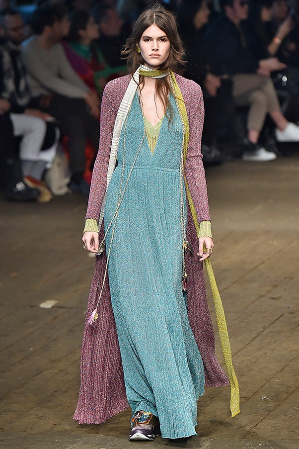 <strong>MISSONI</strong><BR><BR> Missoni tried her hand at bohemian maxi dresses, too, with a series of successful shimmering gowns she layered with colorful floor-length sweaters, skinny scarves and paired with sneakers.