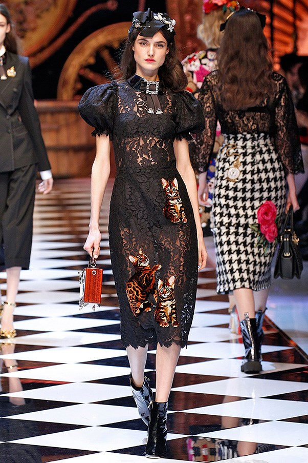 <strong>DOLCE & GABBANA</strong> <BR><BR> As for the evil queen, she had the most wearable, grown-up clothes. As little girls grow up, they tend to see her side of the story, too, which is generally more interesting. (Think Wicked and Maleficent, for instance.) Black lacy widow dresses and power suits were in order, necessary for taking prissy misses down a notch. Her shoe of choice: golden sandals or black lace-up boots a la Doc Martens.
