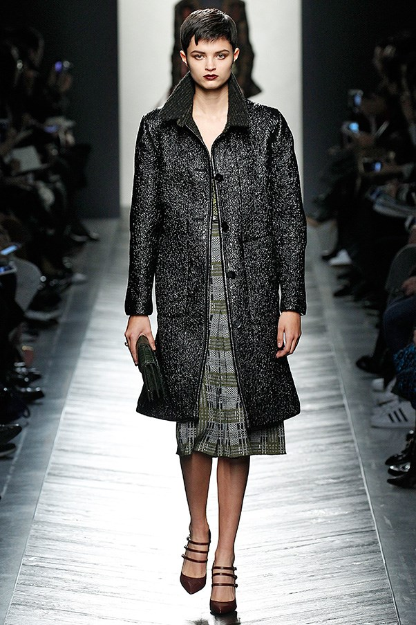 <strong>BOTTEGA VENETA</strong> <BR><BR> Bottega Veneta's autumn winter collection revolved around the fundamentals of a woman's wardrobe: trousers (done long and fluid); coats, shown belted or knee-length; cinched day dresses, subtle cocktail versions, and best in show, the knit sweater-and-pleated-skirt combinations. Within these handful of looks, Maier offered plenty of variety via leather, double-faced cashmere, and printed intarsia knits.