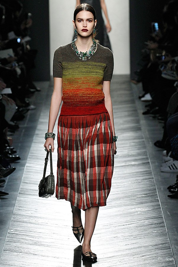 <strong>BOTTEGA VENETA</strong> <BR><BR> The sweater-skirt sets could have felt retro, but they didn't thanks to interesting colour and print mixes, like his reddish tones, which were a nod to Mount Vesuvius of all places. And with every look, of course, came those Bottega leather bags. This season, as muted as the overall collection was, the bag came in bright purple, green, red and yellow crocodile exotics. Their envelope, shoulder and double-bag silhouettes were more petite than in the past. Maier also blew the dust off an archival style from 1971.