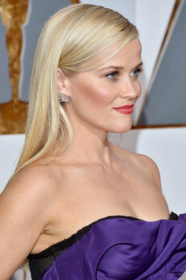 "<strong>REESE WITHERSPOON</strong><BR><BR> ghd hair stylist Lona Vigi applied a ""small amount of nourishing hair oil on Reese's wet hair to create a sleek and sophisticated style. I blow dried her hair with a ghd air ($200) and used a ghd paddle brush ($34) to keep the look smooth. Once dry, I ran a ghd platinum styler ($315) throughout her hair. Then, I applied a small amount of nourishing hair oil to create a shiny and smooth finish for the final look. To keep the hair back and in place, I sprayed the hair with a strong hairspray. <br><br> <em>ghd products are available <a href=""http://www.ghdhair.com/au"">here</a>, for stockist information call 1300 443 424.</em>"