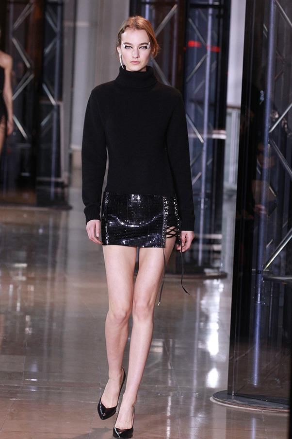 <strong>ANTHONY VACCARELLO</strong><BR><BR> Sex came served up with a healthy dose of control. Vaccarello babes aren't gratuitous in how much leg, shoulder, hip they show—even if it's a lot by most standards. They know what they are doing. There's power here in how covered-up knits were paired with itty-bitty laced-up minis, tuxedo vest mini dresses barely covered much, and even jeans were second-skin.