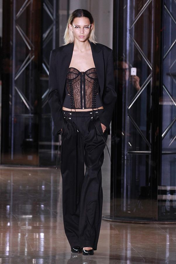 <strong>ANTHONY VACCARELLO</strong><BR><BR> Pleated pants à la '80s cropped up here, but were tempered with ultra femme tops, like a strict bustier done in lace and topped with a mannish blazer. Elsewhere, this notion of binding came through in all the laces Vaccarello used to close skirts and tight strappy sandals.