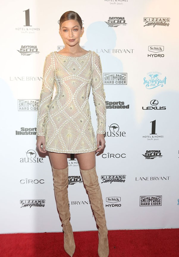 All eyes were on Hadid as she rocks an embellished Herve Leger mini dress with thigh-high suede boots.