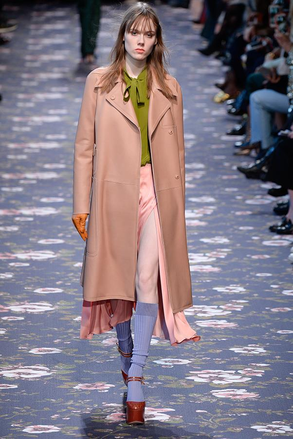<strong>ROCHAS</strong><BR><BR> Alessandro Dell'Acqua is a true romantic, pulling every ounce of flou and femininity out for his fall Rochas runway. As girls walked along a wallpaper floral carpet, even their most tailored coats, couldn't hide the flounce of bow blouses, swish of silky skirts or ruffles and frills beneath.