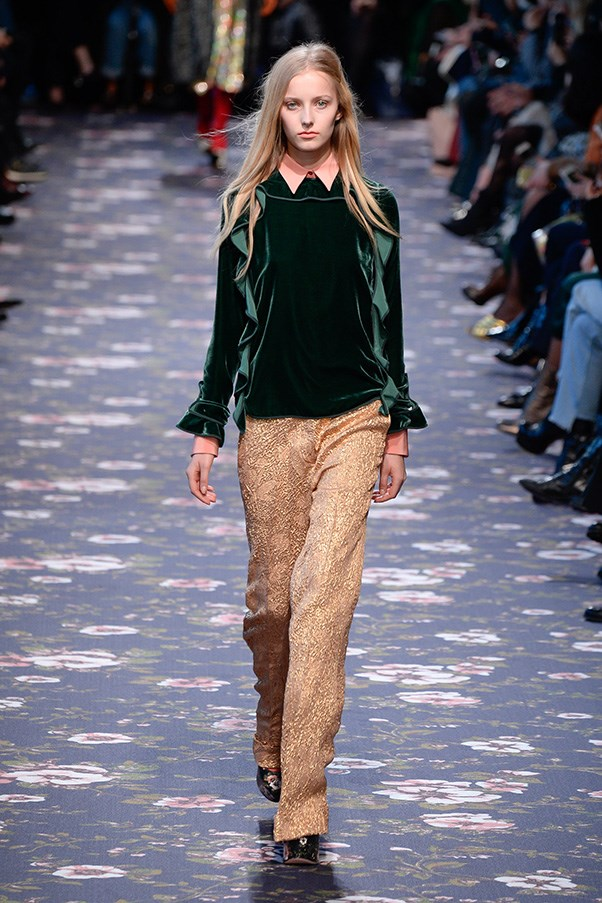 <strong>ROCHAS</strong><BR><BR> Silhouettes were long and relaxed, a strip of ruffles or a high slit echoing a look's fluid movement. Even more buttoned-up ideas, like a collared shirt, sweater and trouser combination, felt more wind-in-the-willows romantic when executed in velvet and textured goldy-pink.