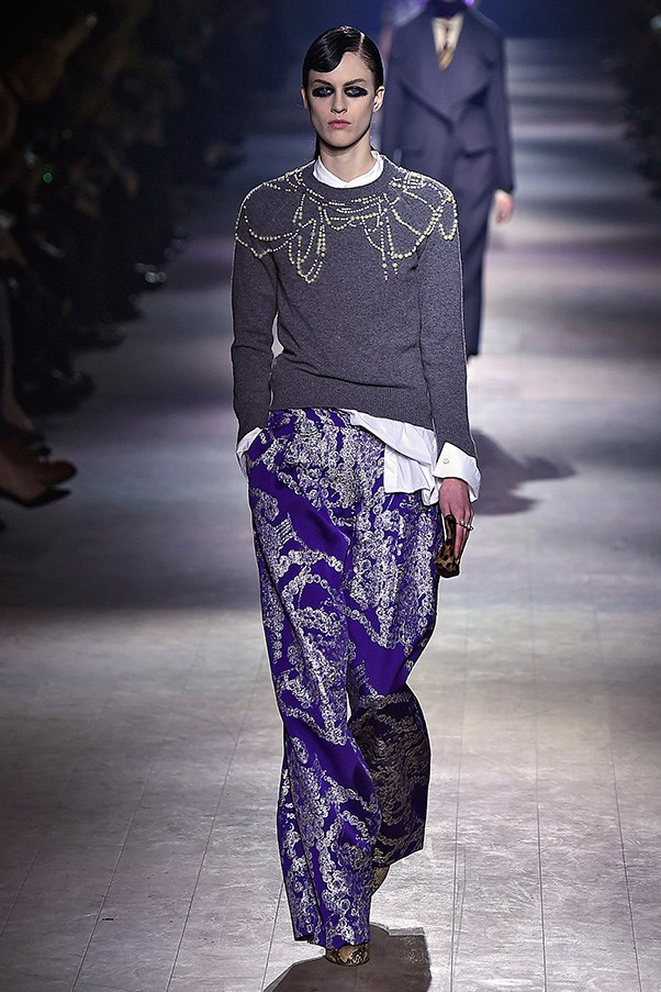 <strong>DRIES VAN NOTEN</strong><BR><BR> But nothing about this was retro, certainly not in the way Van Noten took recognisable silhouettes and materials and spun them in his androgynous, hyper luxe mixer. Why do a pearl necklace when they can serve as a blown-up print on roomy trousers and tunics, accent a basic gray cashmere sweater or serve as netting to be layered at will?