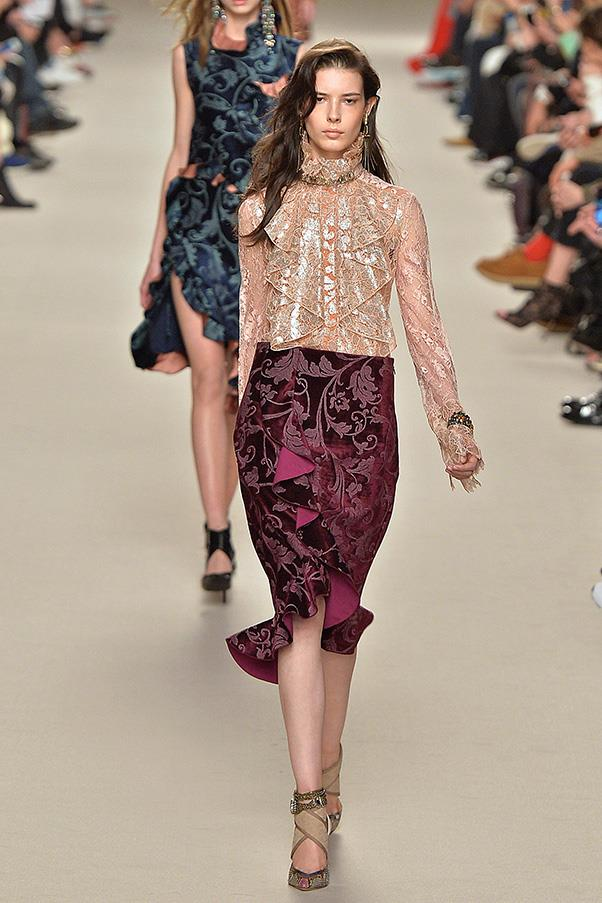 <strong>LANVIN</strong><BR><BR> There was a lovely segue of pattern and print echoing each other through all the Baroque romantic swirls and florals. If you don't get your romance through the golden lace blouses, then surely through the burnt velvet skirts with fluted hems.