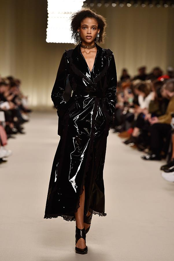 <strong>LANVIN</strong><BR><BR> And as mentioned, there were seeds of fresh ideas and direction here. The patent leather trench trimmed with gentle ruffles was on point with what's happening this season elsewhere but also felt like Lanvin.