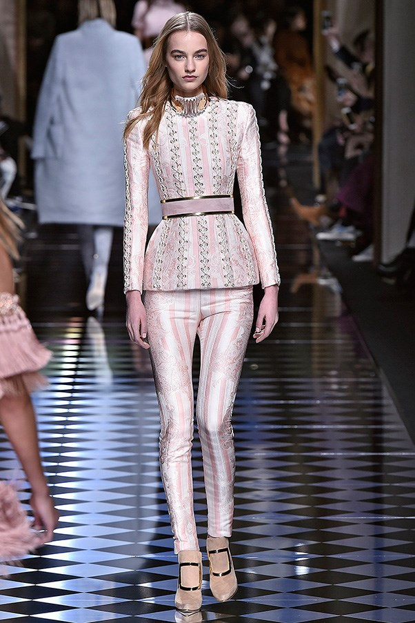 <strong>BALMAIN</strong><BR><BR> A moment for the white pearl-encrusted elephant in front row. Olivier Rousteing's #1 fan Kanye West - with assorted members of the Kardashian clan - was nearly falling out of his seat with bro-love for the Balmain designer (and possibly picking out Kim's outfits for her postpartum doctor's appointments). Kanye was wearing a Balmain jacket, gorgeously embroidered with pearls, over his own gray hoodie, taking the whole high-low thing to a whole new level and drawing attention to just how good young Rousteing's vision and his atelier's execution are.