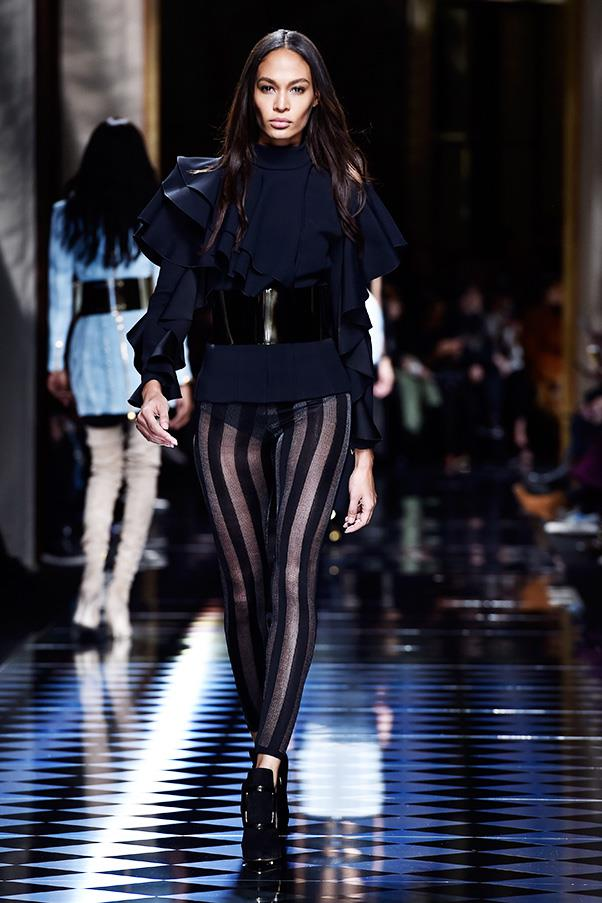<strong>BALMAIN</strong><BR><BR> The autumn winter collection he presented felt like Balmain—tight and curvy, sexy, suggestive, a uniform for his squad of models (including Gigi Hadid and Kendall Jenner who swapped hair colors for the show) who wear him off-duty. There were military details and the strict tailoring that keeps a girl held in all the right places, as well as the body-con leggings and pants.