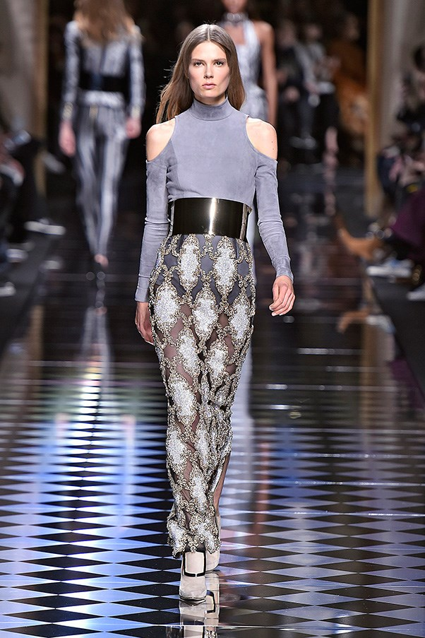 <strong>BALMAIN</strong><BR><BR> Along with white and black, Rousteing sent out steely blue and pale pink. The juxtaposition of these softer hues against corset shapes and cage-like embroideries and Baroque patterns—all cinched with wide metal belts—was striking.