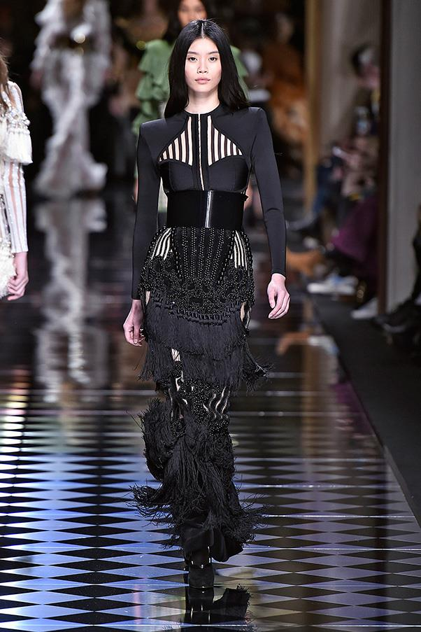 <strong>BALMAIN</strong><BR><BR> It had movement and sound thanks to the swish of a thousand ruffles, frills and tassels that hung and clung from body-con silhouettes. Mini skirts, floor-length gowns and skin-tight pants all featured some kind of swing or swish. Even revealing lace jumpsuits sported tendrils of frills down the side of each leg.