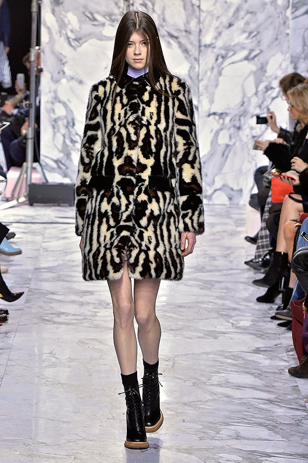 <strong>CARVEN</strong><BR><BR> While the overall story—the influence of travels to far-flung locales and then coming home—was always present, the designers kept things varied. As one would in a real wardrobe. The shearlings were followed by an A-line leopard coat, space knits that could double as outerwear and a pair of motorcycle jackets that, done in a brighter blue, landed on a ladylike note.