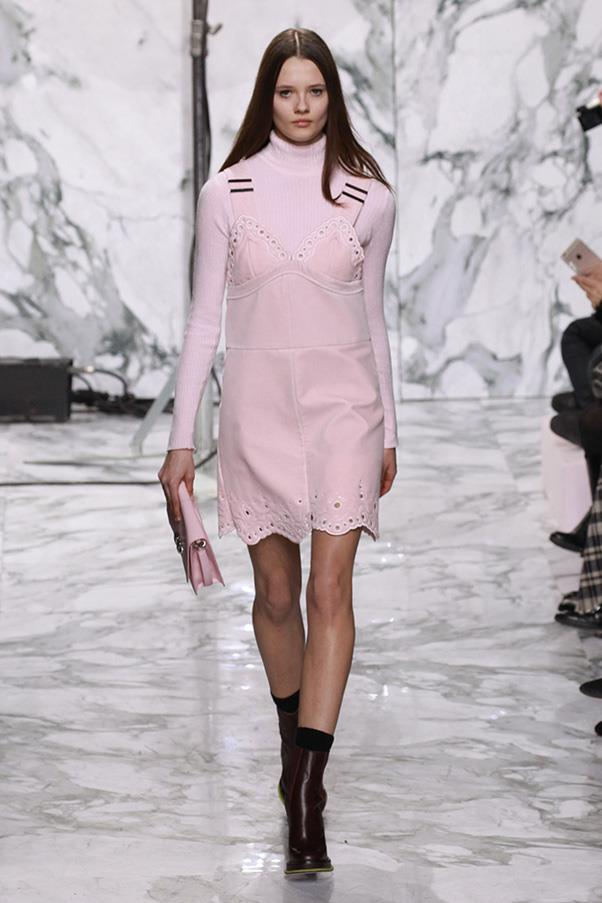 <strong>CARVEN</strong><BR><BR> Carven brought back some of the eyelet details seen in seasons past. This time, it detailed the bodice and hem of a delicate pink suede mini dress (worn with a tonal turtleneck and clutch) and a schoolgirlish green velvet mini teamed with a camel v-neck. Both young and fresh.