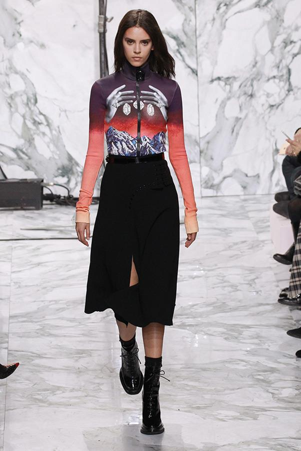 <strong>CARVEN</strong><BR><BR> A lightening print zipped across a zipped ski layer, its zig zag echoing the marble runway and backdrop. And the trippy prints continued with a set of hands dropping crystals against a sunset mountain top or a crystal intarsia sweater. Proving that hippies come in all shapes, forms and styles.