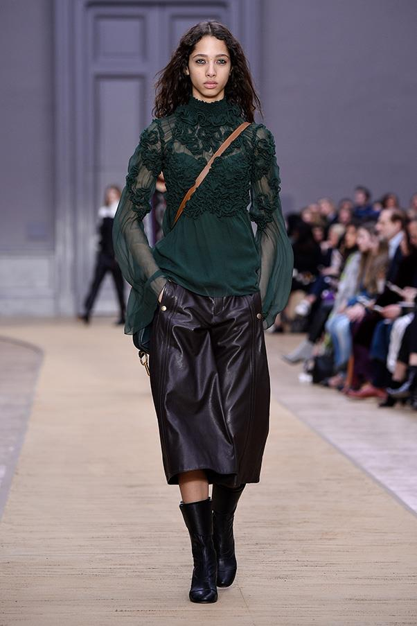 <strong>CHLOE</strong><BR><BR> Within the biker-Bedouin vibe, Waight Keller still injected the flou and flourish that are house tropes. Chiffon blouses were paired with leather chaps and patterned pullovers topped tiers of bohemian ruffles.