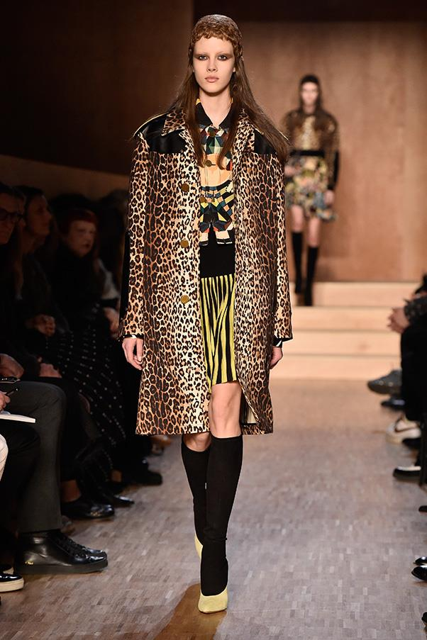 <strong>GIVENCHY</strong><BR><BR> A striped green and black midi skirt is paired with a printed top and leopard coat for a new distinctive Ricardo Tisci aesthetic—maintaining an inarguable cool while inviting in texture and pattern.