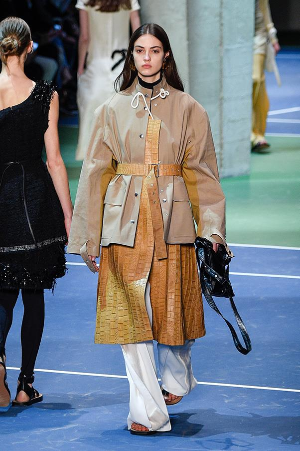 <strong>CÉLINE</strong><BR><BR> There was a welcome utility vibe on khaki anoraks, elevated by an alligator coat underneath. One standout bag wrapped around the wrist, another featuring double straps—all in basic, must-have colors, black, cream, red.
