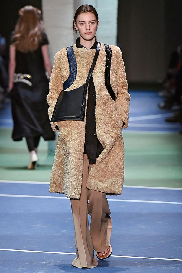 <strong>CÉLINE</strong><BR><BR> Only Philo can make a collection that's so largely about coats and pair them with leather sandals, and still have it all make sense. A tan-and-black leather shearling was a heart-stopper, paired with an easy black bag slung insouciantly over the shoulder.