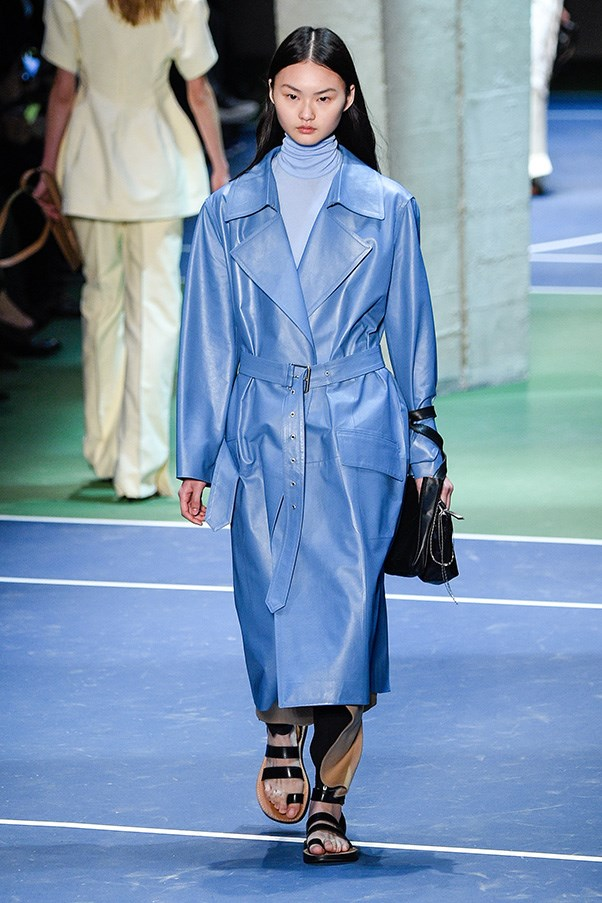<strong>CÉLINE</strong><BR><BR> The pièce de résistance has to be a blue leather trench—one of two in the collection. It introduces a new, cool shade without trading on the Philo's signature clean minimalism. It's that bag wrapped around the wrist, the Jesus sandals, the matching turtleneck—the moments that make the look and bring the Céline woman back for more, season after season.