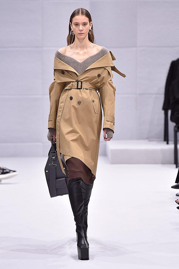 "<strong>BALENCIAGA</strong><BR><BR> Next up: the cocoon coat. Gvasalia interpreted the famed silhouette by reinventing the classics - the trench, the denim jacket, the puffer, the shearling - pulling them off the shoulder and cinching them at the waist. The show noted championed this approach as ""a reimagining of the work of Cristóbal Balenciaga - a wardrobe of absolute contemporaneity and realism imbued with the attitude of haute couture. A transition, not a reiteration. A new chapter."""
