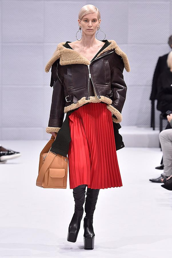 <strong>BALENCIAGA</strong><BR><BR> The accessories didn't disappoint: The earrings were big and silver, the bags sleek but utilitarian at heart and the boots came ultra-fitted with a sizable platform—a look the designer is also exploring at his label Vetements.