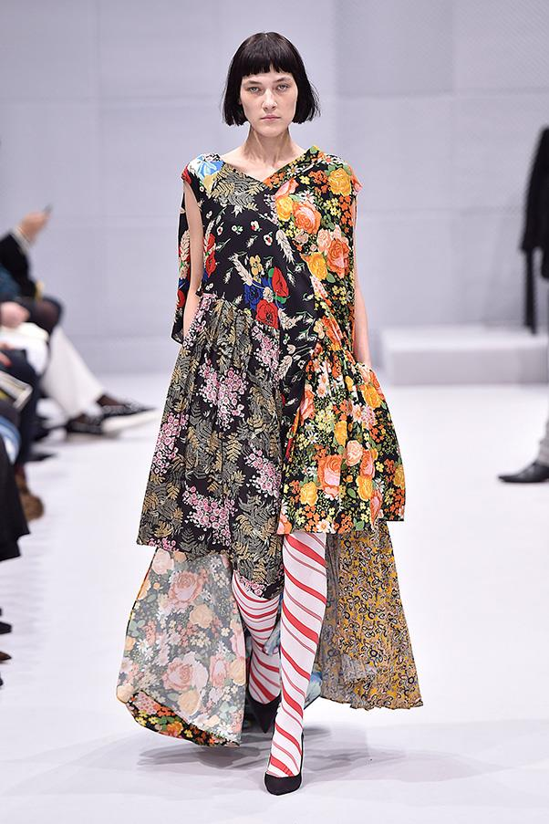 <strong>BALENCIAGA</strong><BR><BR> The spirit of Vetements, the three-seasons-old collection designed by Gvasalia and a collective, was evident in more than footwear. The brand has a knack for taking streetwear to elevated places—and loves an oversized floral dress. Gvasalia explored that idea for Balenciaga, pairing the pieces with either matching floral or candy cane striped tights. It's a welcome dose of whimsy.