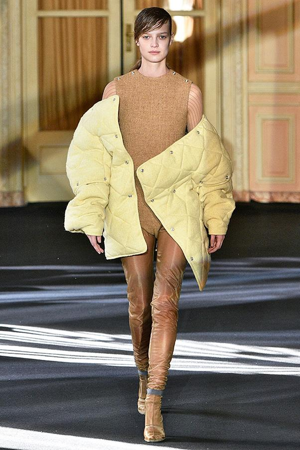 <strong>ACNE STUDIOS</strong><BR><BR> Wool bodysuits are a hard sell, not quilted puffers. Quilted puffer coats  have gotten a bad rap in the last decade or so thanks to massive chains and fast fashion who churn out humdrum styles that turn wintry sidewalks - city and suburban alike - into moving shapeless black and grey morasses. But Johanssen is pitching something fun, vibrant, and thankfully, warm. His puffers came in bright Easter colours, soft pastels and traditional neutrals. And he bypassed nylon for softer materials and added snaps to the sleeves so you can turn your puffer into a vest.