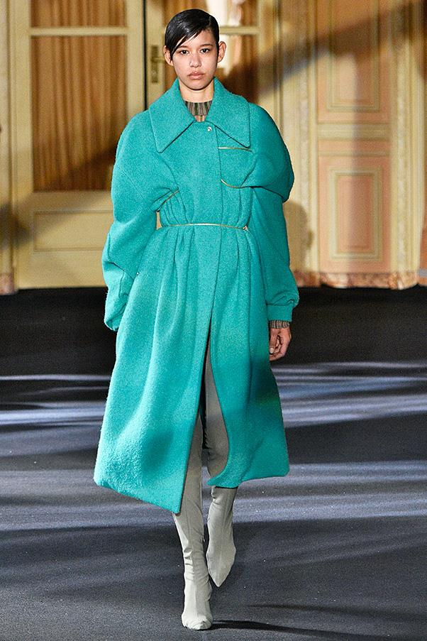 "<strong>ACNE STUDIOS</strong><BR><BR> While the collection skewed towards artiness, there were several refined ladylike moments (think Bjork). The cozy coats—in camel, red, blue, gray, a patchwork yellow-green-blue leopard or a pale aqua—looked right on, especially ""belted"" with a coil of gold wire for definition."