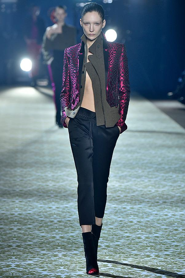 <strong>HAIDER ACKERMANN</strong><BR><BR> Elsewhere, wool military jackets were cropped at the waist and cut an angle. It was all so sharp and architectural, it made the accenting colour palette and material that much more interesting: fuchsia silk and vibrant pink and orange-red velvet. Often, the tailored utilitarian pieces were layered under or over bright silk brocades or rich glossy velvets. You wanted to look and feel the clothes as much as you wanted to wear them.