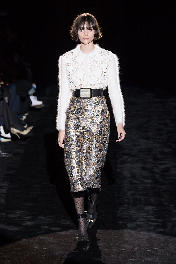 <strong>EMANUEL UNGARO</strong><BR><BR> Puglisi was adventurous with texture and print within a feminine silhouette. So the most flattering pencil skirts, v-necks and silky blouses were spun in interesting mixes of lace, knit, jacquard and appliques.