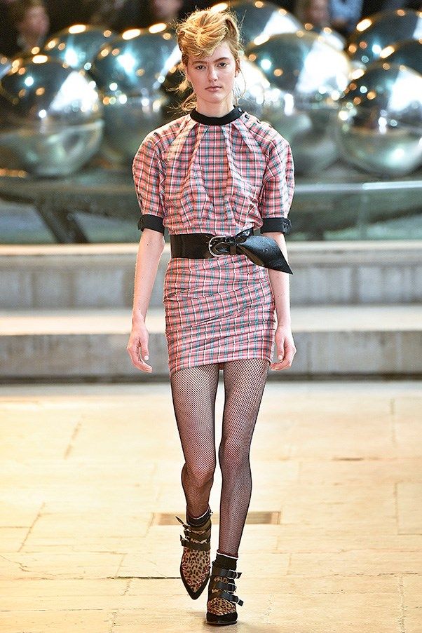 <strong>ISABEL MARANT</strong><BR><BR> Dresses, blouses and minis came out in men's wear-inspired checks, plaids and the like, but were then puffed at the shoulder, cinched at the waist and hemmed mid-thigh. And let's have a moment for those pointy-toed booties which brought a whiff of nostalgia to anyone who loved Duckie from <em>Pretty in Pink</em>. Marant respun them in leopard and zebra with tons of straps.