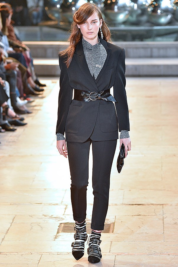 <strong>ISABEL MARANT</strong><BR><BR> Even her most reined-in looks—a draped check dress, a trench and a black pant suit—were dipped in the '80s redux thanks to wide cinched belts and those zippy shoes.