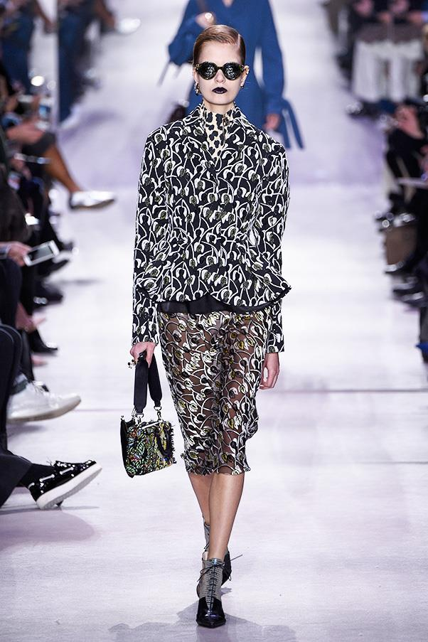 <strong>DIOR</strong><BR><BR> The colour palette was dark or cream except for pops of citrus-y green, orange and colorful silk printed separates. Interspersed were those typically Parisian archetypes—the hint of leopard and a strong lip color. Throughout, the design duo reworked Dior's iconic Bar jacket, part of the late 1940s New Look (and which Harper's Bazaar dedicated pages to back in the day, detailing even Dior's sketches of this revolutionary silhouette). The gently sloped shoulder, cinched waist and exaggerated hip could be spotted in some variation here, in nearly every coat and jacket.
