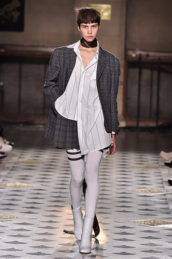<strong>VETEMENTS</strong><BR><BR> They took the notion of prep school uniforms and twisted and distorted it. Tube socks stretched up above the knee provocatively while button-down shirts, pleated mini skirts and matching blazers were in various states of dishabille. And the ties were cinched around the necks.