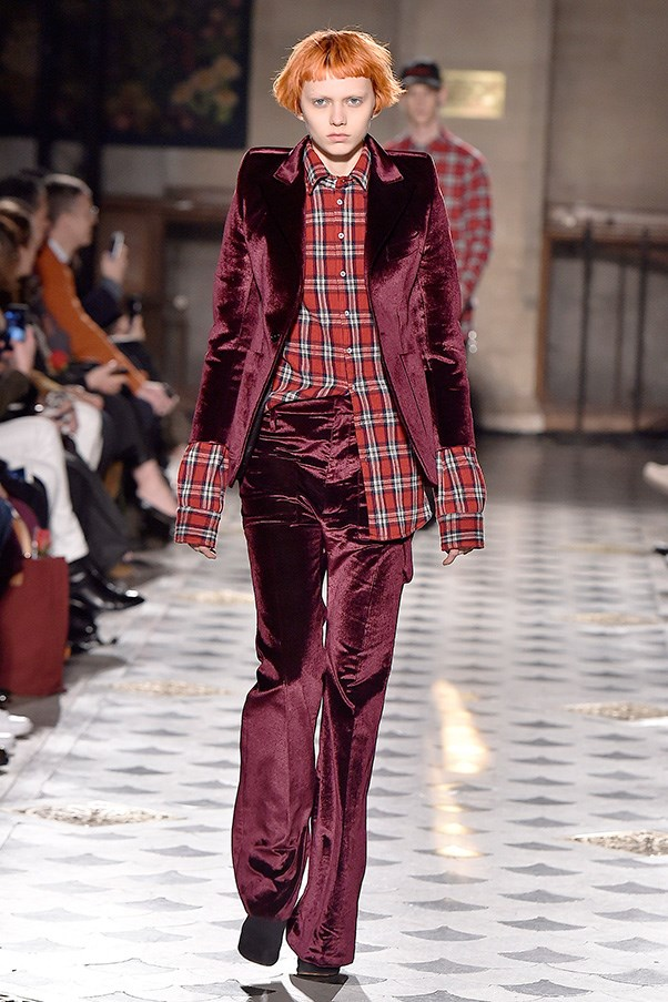 <strong>VETEMENTS</strong><BR><BR> The peak shoulders from last season turned into hyper-shrug shouldered velvet jackets, plaid shirts and button-downs that looked like they had football pads under them. Sometimes the models' demeanor, coupled with the oddly-squared shoulders was disquieting.