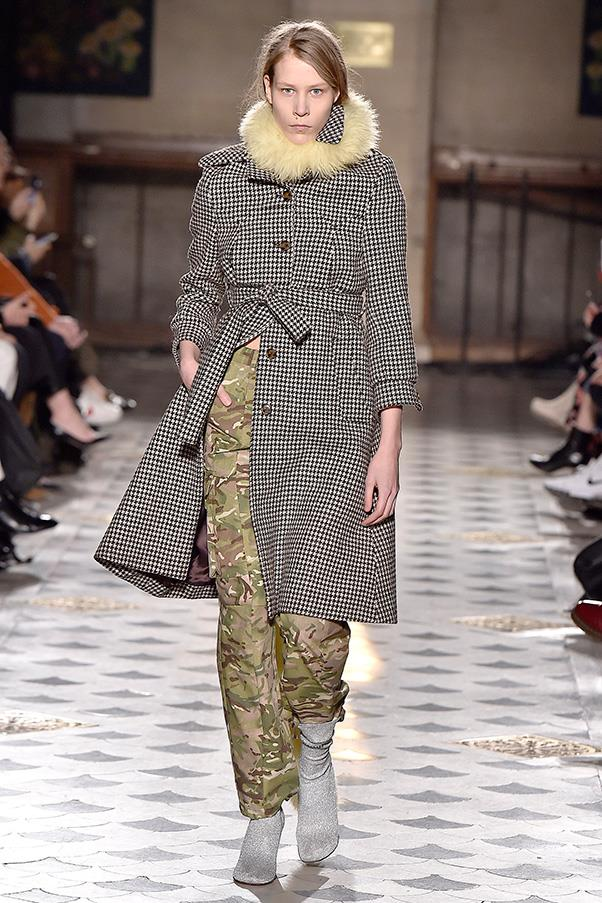 <strong>VETEMENTS</strong><BR><BR> But the things that made everyone go ooh and ah last season were still there. Ruffled girly blouses worn over leather chaps provocatively printed with guns and love on one leg and hate on the other. And artful mixes of camo pants with traditional coats cut in haberdasher's materials. It's just that everything was always a little off, which is the point.
